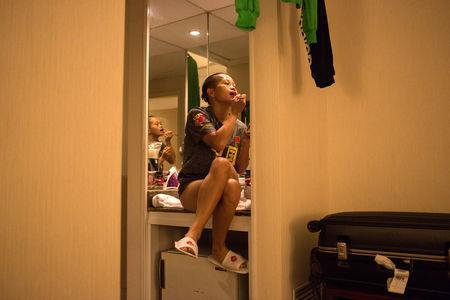 Huang Wensi applies makeup in her hotel room before the match in Taipei, Taiwan, September 26, 2018. REUTERS/Yue Wu