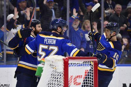 Mar 19, 2019; St. Louis, MO, USA; St. Louis Blues left wing David Perron (57) celebrates with center Ryan O'Reilly (90) and center Brayden Schenn (10) after scoring his second goal of the game during the third period against the Edmonton Oilers at Enterprise Center. Mandatory Credit: Jeff Curry-USA TODAY Sports