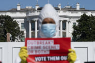 A person with MoveOn.org Political Action protests the ongoing outbreak of coronavirus in the White House, Thursday, Oct. 8, 2020, outside the White House in Washington. (AP Photo/Jacquelyn Martin)