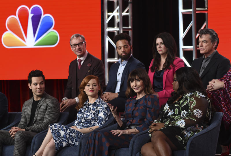"FILE - In this Jan. 11, 2020, file photo, Mary Steenburgen, second from right in the bottom row, a cast member in the NBCUniversal series ""Zoey's Extraordinary Playlist,"" discusses the show at the 2020 NBCUniversal Television Critics Association Winter Press Tour, in Pasadena, Calif. Looking on from left in the front row are cast members Skylar Astin, Jane Levy and Alex Newell. From left in the back row are executive producer Paul Feig and cast members John Clarence Stewart, Lauren Graham and Peter Gallagher. Levy stars as Zoey, a computer coder who hears people's private thoughts through pop songs, in the series airing 9 p.m. EST  Sunday, Feb. 16, on NBC. (AP Photo/Chris Pizzello, File)"