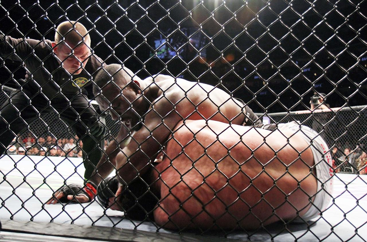 Champion Jon Jones, top, lands an elbow against Chael Sonnen during their UFC 159 Mixed Martial Arts light heavyweight title bout in Newark, N.J., Saturday, April 27,2013. Jones retained his title via first round TKO. (AP Photo/Gregory Payan)