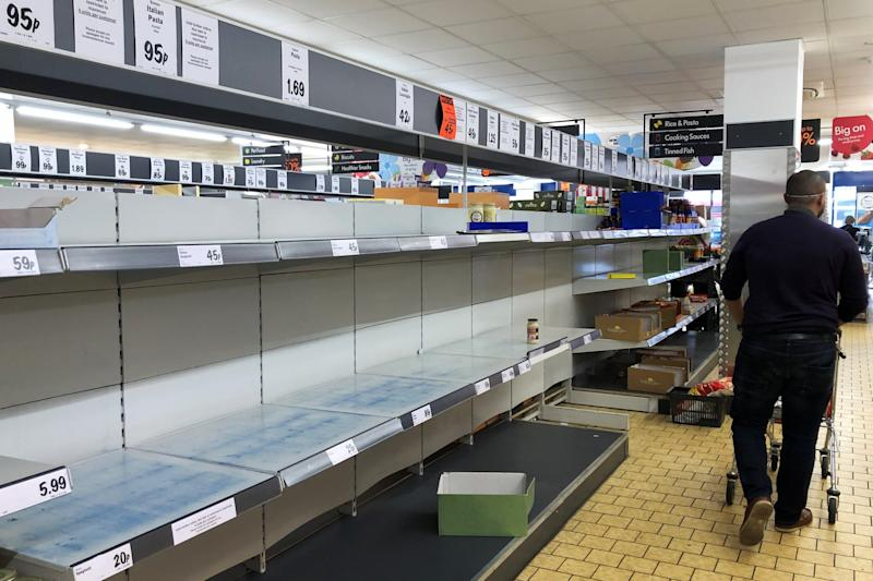 A shopper walks past empty shelves in a Lidl store in Wallington in March at the peak of the pandemic: Getty Images