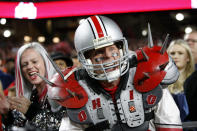 FILE - In this Dec. 28, 2019, file photo, Ohio State fans celebrate after a touchdown during the second half of the team's Fiesta Bowl NCAA college football playoff semifinal against Clemson in Glendale, Ariz. The goal is for all of major college football _ 130 teams in 10 conferences across 41 states _ to start a season at the same time and play an equal number of games. It is becoming more apparent the coronavirus pandemic is going to make that goal difficult to achieve. (AP Photo/Ross D. Franklin, File)