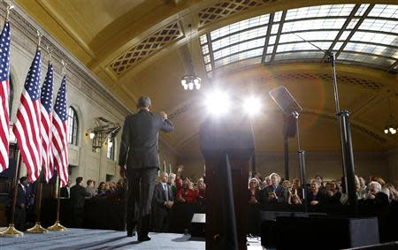 U.S. President Barack Obama waves after speaking at Union Depot in St. Paul, Minnesota February 26, 2014. REUTERS/Kevin Lamarque