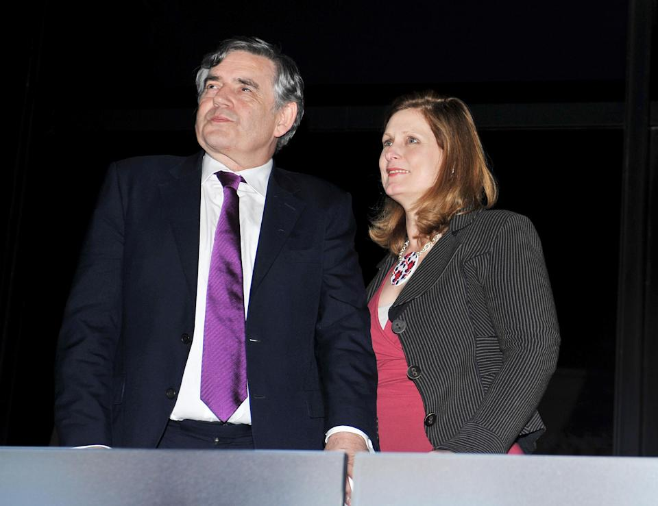 LONDON, ENGLAND - JULY 27: Former Prime Minister Gordon Brown and his wife Sarah look on ahead of the Olympic Games 2012 Opening Ceremony on July 27, 2012 in London, England. Athletes, heads of state and dignitaries from around the world have gathered in the Olympic Stadium for the opening ceremony of the 30th Olympiad. London plays host to the 2012 Olympic Games which will see 26 sports contested by 10,500 athletes over 17 days of competition. (Photo by John Stillwell - WPA Pool/Getty Images)