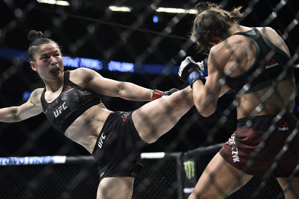 LAS VEGAS, NEVADA - MARCH 07: (L-R) Zhang Weili of China kicks Joanna Jedrzejczyk of Poland in their UFC strawweight championship fight during the UFC 248 event at T-Mobile Arena on March 07, 2020 in Las Vegas, Nevada. (Photo by Chris Unger/Zuffa LLC)