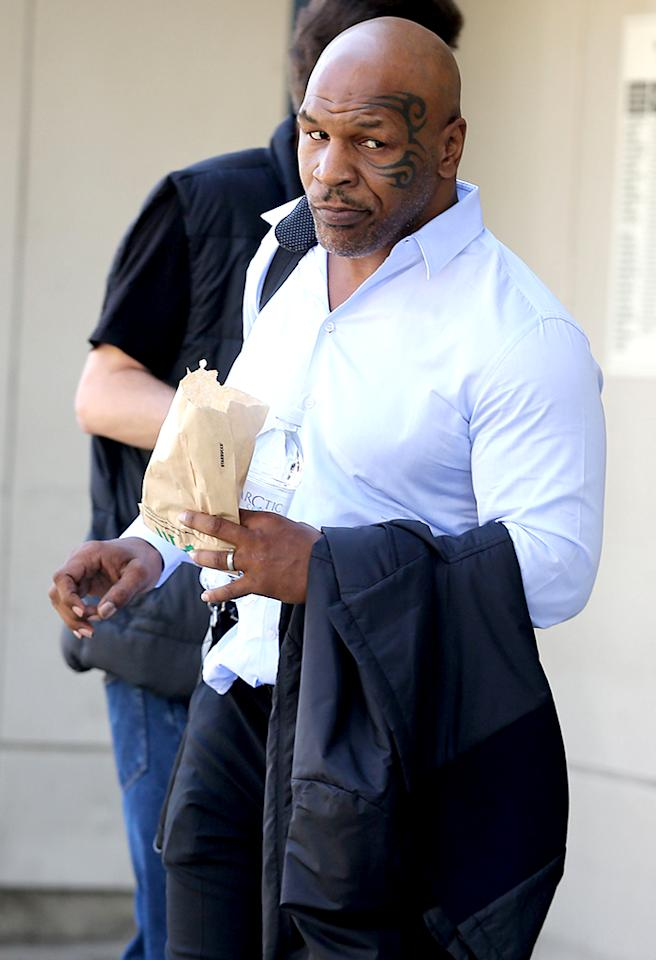 Mike Tyson and his wife spotted at LAX. The former championship boxer was seen munching at Starbucks in the American Airlines terminal at LAX. Pictured: Mike Tyson   Ref: SPL525449  120413  Picture by: Sharky / Splash News   Splash News and Pictures Los Angeles:310-821-2666 New York:212-619-2666 London:870-934-2666 photodesk@splashnews.com
