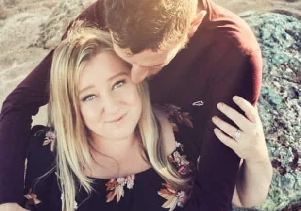 Toni Lannigan, shown in an engagement photo with her fiancé, says she is still not herself after having a serious allergic reaction to the Pfizer BioN-Tech vaccine.  (Tracy Stewart - image credit)