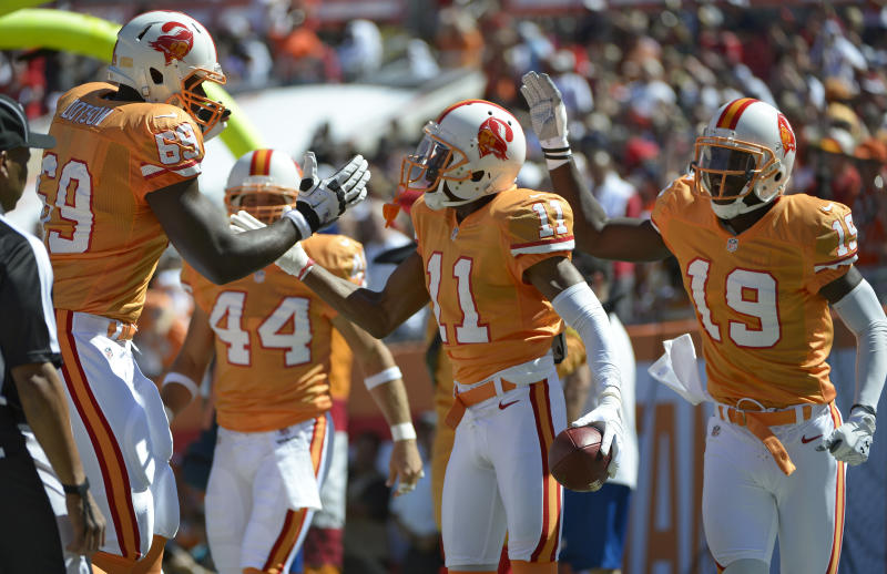 Tampa Bay Buccaneers wide receiver Tiquan Underwood (11) celebrates with teammates tackle Demar Dotson (69) and wide receiver Mike Williams after scoring a touchdown during the first quarter of an NFL football game Sunday, Oct. 21, 2012, in Tampa, Fla. (AP Photo/ Phelan Ebenhack)