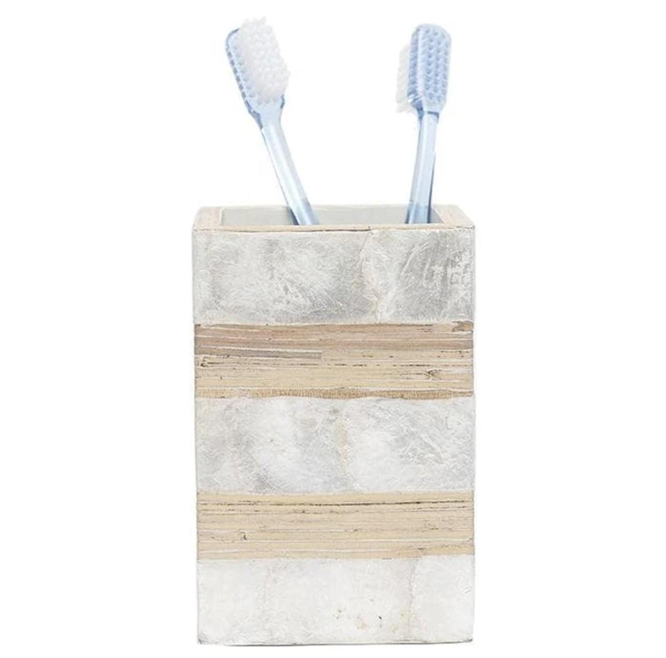 <p>Life's a beach with the <span>Salerno Capiz Shell Brush Holder</span> ($80) from Hudson and Vine. Though admittedly a splurge, this toothbrush holder is part of a seashell and rattan bathroom accessory set that will transport you to an oceanside oasis each time you brush your teeth.</p>