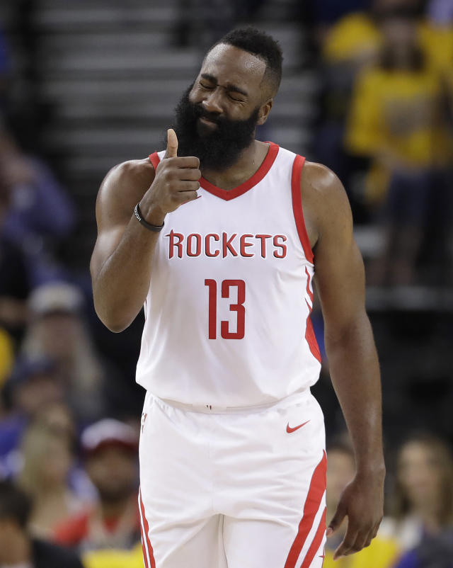 Houston Rockets guard James Harden (13) gestures during the first half of Game 4 of the NBA basketball Western Conference Finals between the Golden State Warriors and the Rockets in Oakland, Calif., Tuesday, May 22, 2018. (AP Photo/Marcio Jose Sanchez)