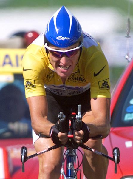 "FILE - In this July 24, 1999 file photo, overall leader Lance Armstrong of the U.S. strains on his way to winning the 19th stage of the Tour de France cycling race, a 57-kilometer individual time trial around the Futuroscope theme park near Poitiers, western France. Tyler Hamilton makes allegations in his book, ""The Secret Race. Inside the Hidden World of the Tour de France, Doping, Cover-ups and Winning at All Costs,"" that Armstrong gave him an illegal blood booster at his house before the 1999 Tour de France and the two teammates compared notes on using performance-enhancing drugs as far back as 1998. The book is set to be published Sept. 5. The Associated Press purchased a copy Thursday. AP Photo/Laurent Rebours, File)"
