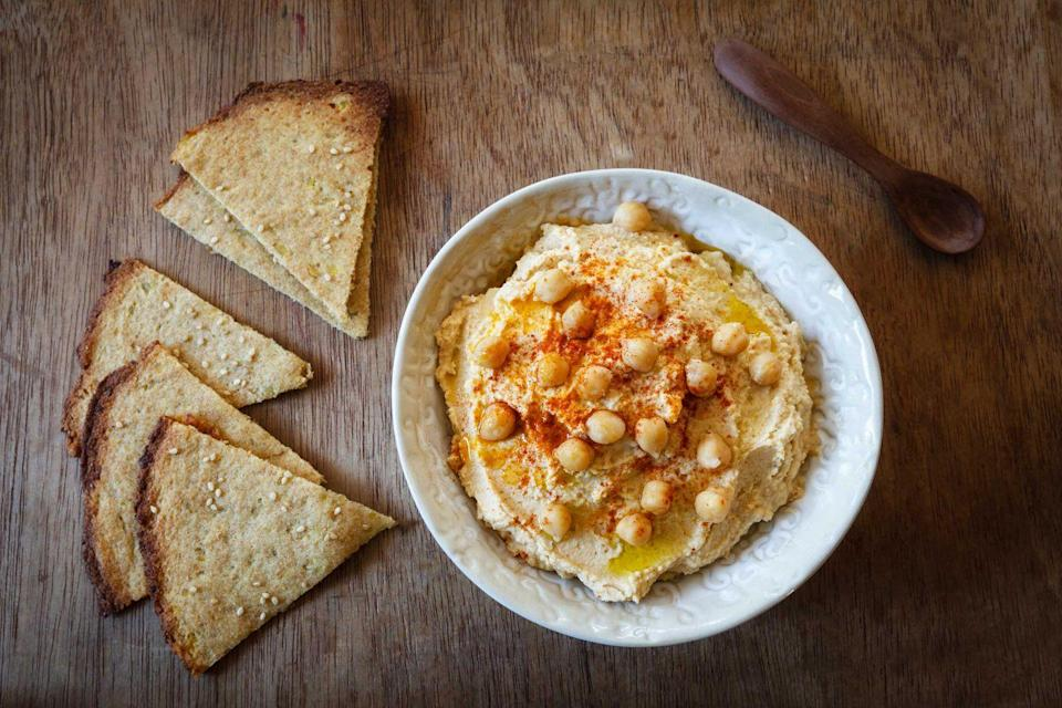 "<p>As <a href=""https://israel.travel/"" rel=""nofollow noopener"" target=""_blank"" data-ylk=""slk:Israel's"" class=""link rapid-noclick-resp"">Israel's</a> national dish, hummus can be found at every street corner in the country. It's traditionally served on a sharable plate, drizzled with olive oil and herbs alongside fresh pita, tomato, onion, cucumber salad and sometimes falafel. There's so many ways to change up this classic dish from buffalo style, <a href=""https://www.countryliving.com/life/a31225121/aldi-dill-pickle-hummus/"" rel=""nofollow noopener"" target=""_blank"" data-ylk=""slk:dill style"" class=""link rapid-noclick-resp"">dill style</a> and even using cauliflower.</p><p><strong>Get the recipe at <a href=""https://www.delish.com/cooking/recipe-ideas/recipes/a50843/cauliflower-hummus-recipe/"" rel=""nofollow noopener"" target=""_blank"" data-ylk=""slk:Delish"" class=""link rapid-noclick-resp"">Delish</a>.</strong></p>"
