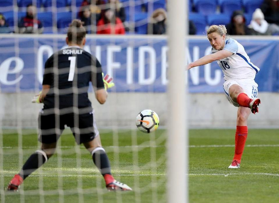 Birmingham City striker Ellen White (R) saved the day with a 73rd minute equalizer to hold multiple European champions Germany to a 2-2 draw (AFP Photo/ELSA)