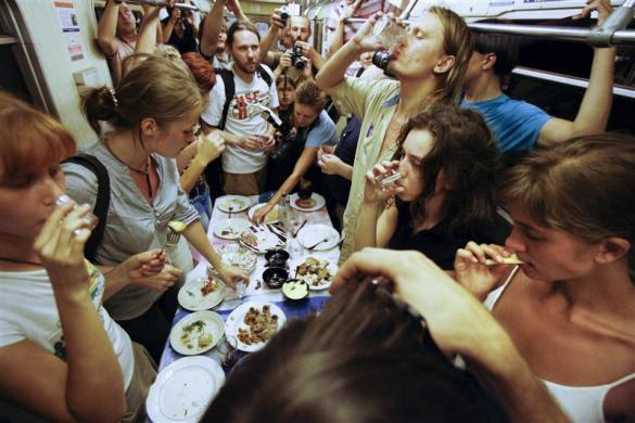 Nadezhda Tolokonnikova (bottom R) and fellow activists celebrate a wake for conceptual artist Dmitry Prigov in a Moscow metro carriage, August 24, 2007. Tolokonnikova later became a member of Pussy Riot.