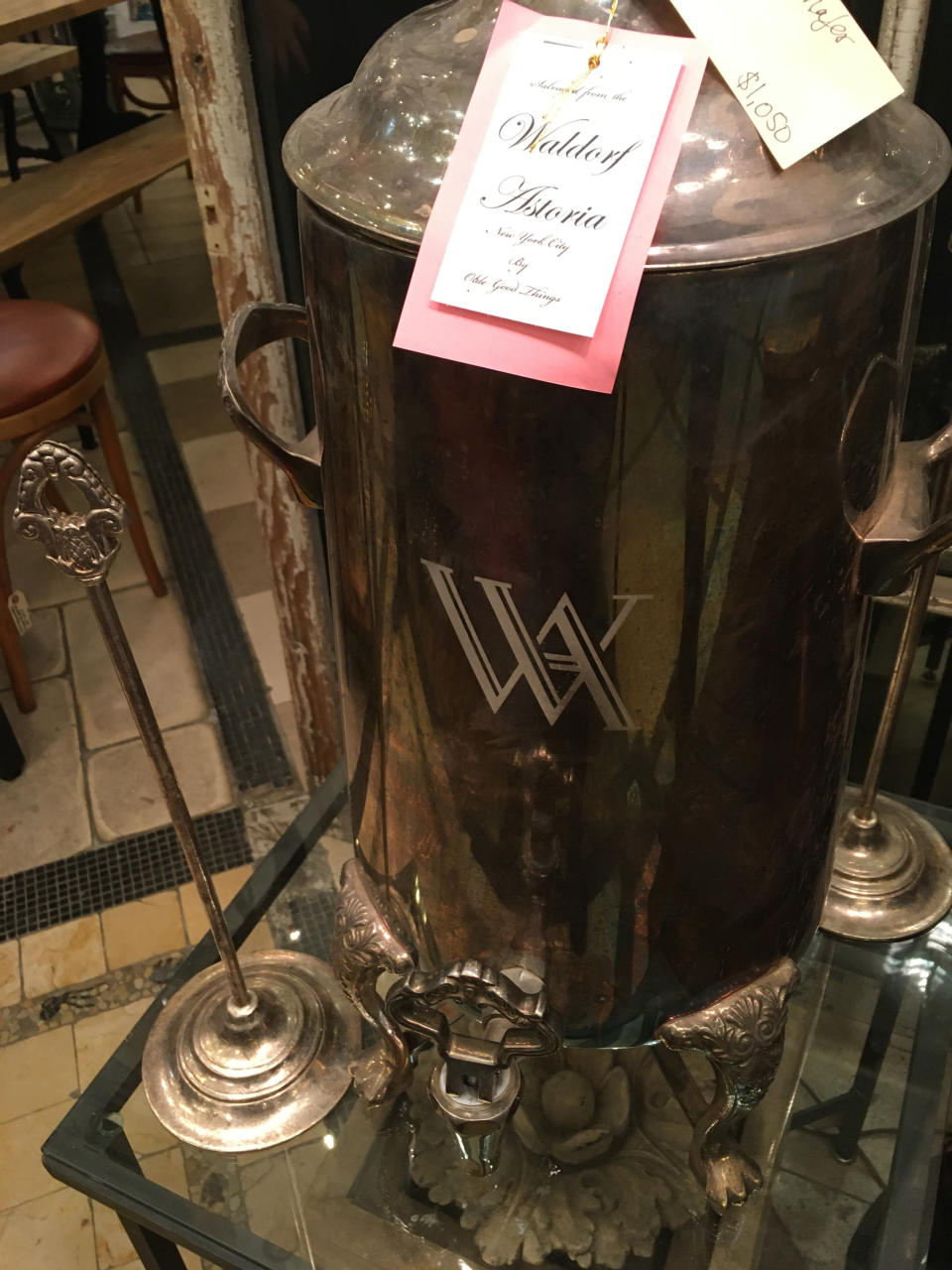 """This Oct. 15, 2019 photo shows an old coffee/tea dispenser from the Waldorf-Astoria Hotel in New York, which is now available for sale at Olde Good Things salvage store in New York. Two of the hottest trends in home decor are sustainability and authenticity. """"It's about both history and sustainability,"""" says Madeline Beauchamp of Olde Good Things, one of the oldest architectural salvage businesses in the country, with one shop in Los Angeles, another in Scranton, Pennsylvania, two stores in New York, and a flagship store to open soon in Midtown Manhattan. (Katherine Roth via AP)"""