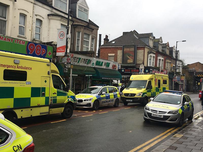 Police outside the butcher's shop on Sunday morning. (Twitter/@fumingchu)