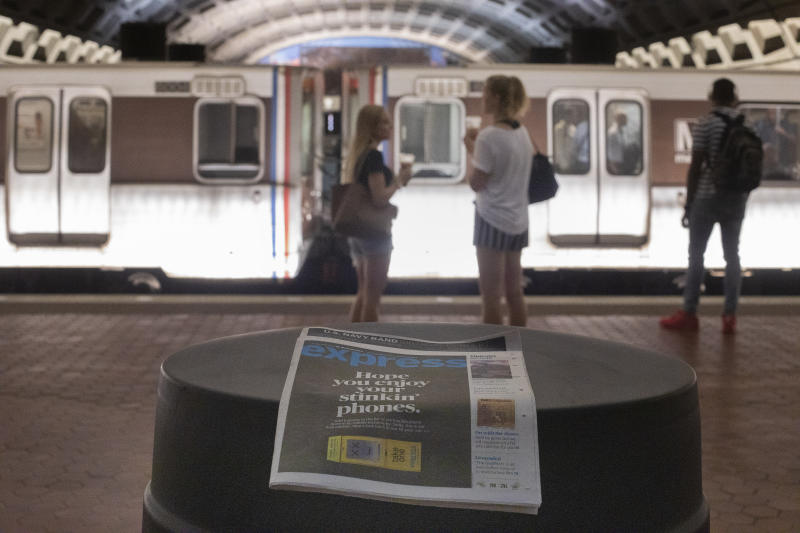 A final copy of the free commuter paper, Express, is seen at a Metro Center Station in downtown Washington, Thursday, Sept. 12, 2019. The Washington Post announced yesterday that it has decided to cease publication of its Express commuter paper, that has been handed out for free at Metro stations for 16 years. (AP Photo/Pablo Martinez Monsivais)