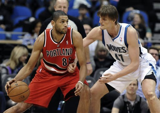 Minnesota Timberwolves' Andrei Kirilenko, right, of Russia, eyes Portland Trail Blazers' Nicolas Batum, of France, during the first quarter of an NBA basketball game, Saturday, Jan. 5, 2013, in Minneapolis. (AP Photo/Jim Mone)