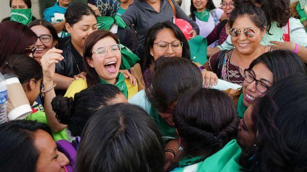 PHOTO: Feminists of the so-called 'Green Tide' celebrate and wave handkerchiefs after the Oaxaca State Congress decriminalized abortion by approving an opinion authorizing the legal termination of pregnancy before 12 weeks gestation, in Oaxaca, Mexico. (Daniel Ricardez/EPA-EFE/REX)
