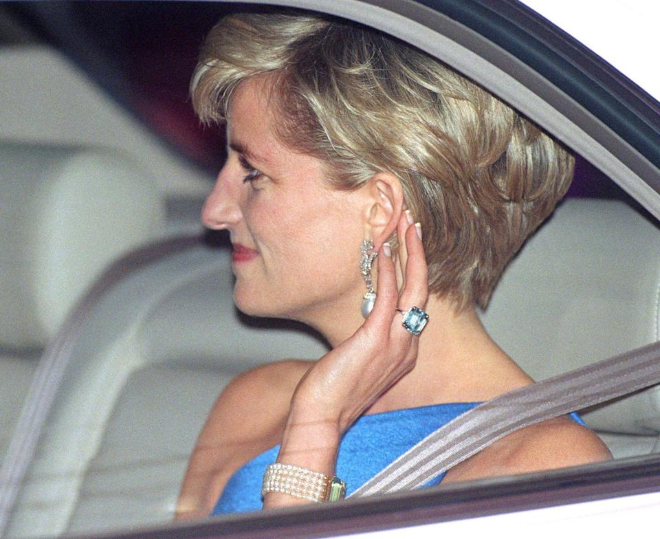 """<p>This glorious aquamarine ring was crafted by Asprey upon Diana's divorce so that she would have something to wear on her ring finger. The ring was passed on to Prince Harry upon her death, and Meghan Markle wore it to the couple's wedding reception. The stone is estimated to be 30 carats and serves as <a href=""""https://www.etsy.com/ca/listing/624736410/meghan-markle-inspired-aquamarine-ring?utm_custom1=www.hellomagazine.com&source=aw&utm_source=affiliate_window&utm_medium=affiliate&utm_campaign=us_location_buyer&utm_term=3657&utm_content=78888&awc=6220_1598898713_ef849fa7055d51f056edc23807fa9607"""" rel=""""nofollow noopener"""" target=""""_blank"""" data-ylk=""""slk:inspiration for costume jewelry"""" class=""""link rapid-noclick-resp"""">inspiration for costume jewelry</a> to this day. </p>"""