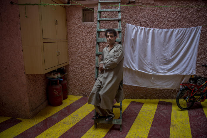 Babloo Shiekh, a transgender Kashmiri, sits for a photograph at home in Srinagar, Indian controlled Kashmir, Wednesday, June 2, 2021. Babloo is one of the head transgenders, one of the few who live with family. Most of Kashmir's transgender people are ostracized by families and bullied in society. They face domestic abuse and end up running away from families at an early age. Some lack housing, education and other basic resources. (AP Photo/Dar Yasin)