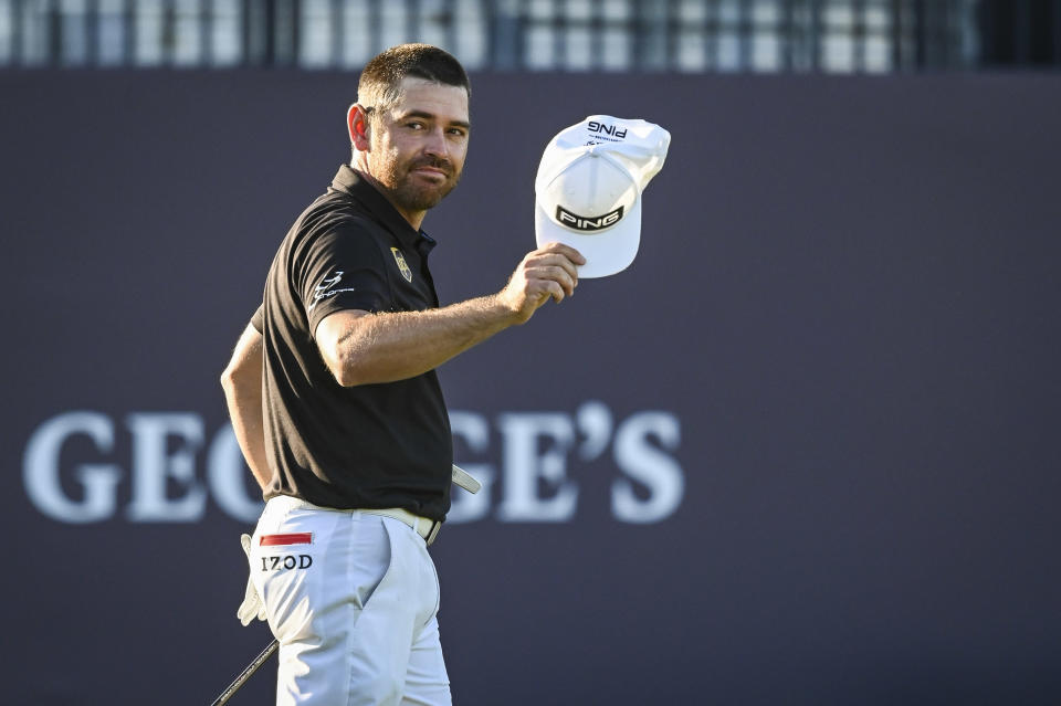Pictured here, Louis Oosthuizen salutes fans after his second round at The Open.