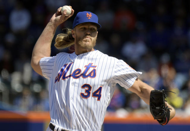 New York Mets starting pitcher Noah Syndergaard throws to the Washington Nationals during the first inning of a baseball game Thursday, April 4, 2019, in New York. (AP Photo/Bill Kostroun)