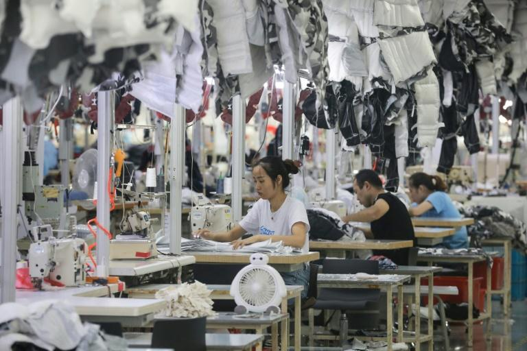 China's economy has been hit by cooling domestic demand and the long-running trade dispute with the United States