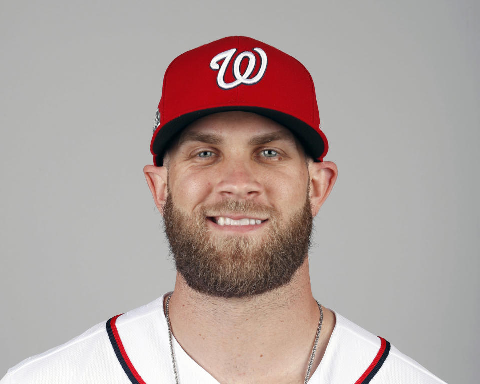 FILE - In this Feb. 22, 2018, file photo, Bryce Harper of the Washington Nationals baseball team poses in West Palm Beach, Fla. A person familiar with the negotiations tells The Associated Press that Bryce Harper and the Philadelphia Phillies have agreed to a $330 million, 13-year contract, the largest deal in baseball history. The person spoke to the AP on condition of anonymity Thursday, Feb. 28, 2019, because the agreement is subject to a successful physical. (AP Photo/Jeff Roberson, File)