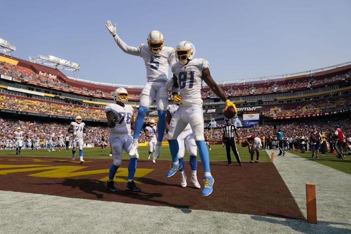 Los Angeles Chargers wide receiver Mike Williams (81) celebrates his touchdown with teammate wide receiver Josh Palmer (5) during the second half of an NFL football game against Washington Football Team, Sunday, Sept. 12, 2021, in Landover, Md. Chargers won 20-16. (AP Photo/Andrew Harnik)