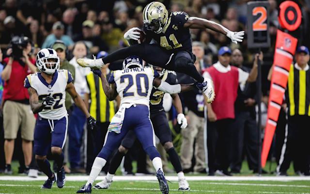 New Orleans Saints running back Alvin Kamara hurdles Rams safety Lamarcus Joyner in his team's 45-35 win on Sunday - USA TODAY Sports