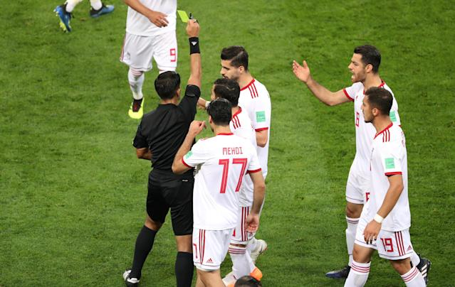 Soccer Football - World Cup - Group B - Iran vs Portugal - Mordovia Arena, Saransk, Russia - June 25, 2018 Iran's Ehsan Hajsafi is shown a yellow card by referee Enrique Caceres REUTERS/Lucy Nicholson