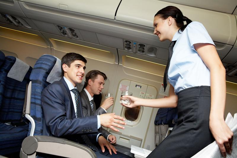 An exit row plus an in-flight cocktail: Fun for the moment, anyway.