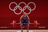 <p>TOKYO, JAPAN - JULY 31: Xiaojun Lyu of Team China competes during the Weightlifting - Men's 81kg Group A on day eight of the Tokyo 2020 Olympic Games at Tokyo International Forum on July 31, 2021 in Tokyo, Japan. (Photo by Chris Graythen/Getty Images)</p>