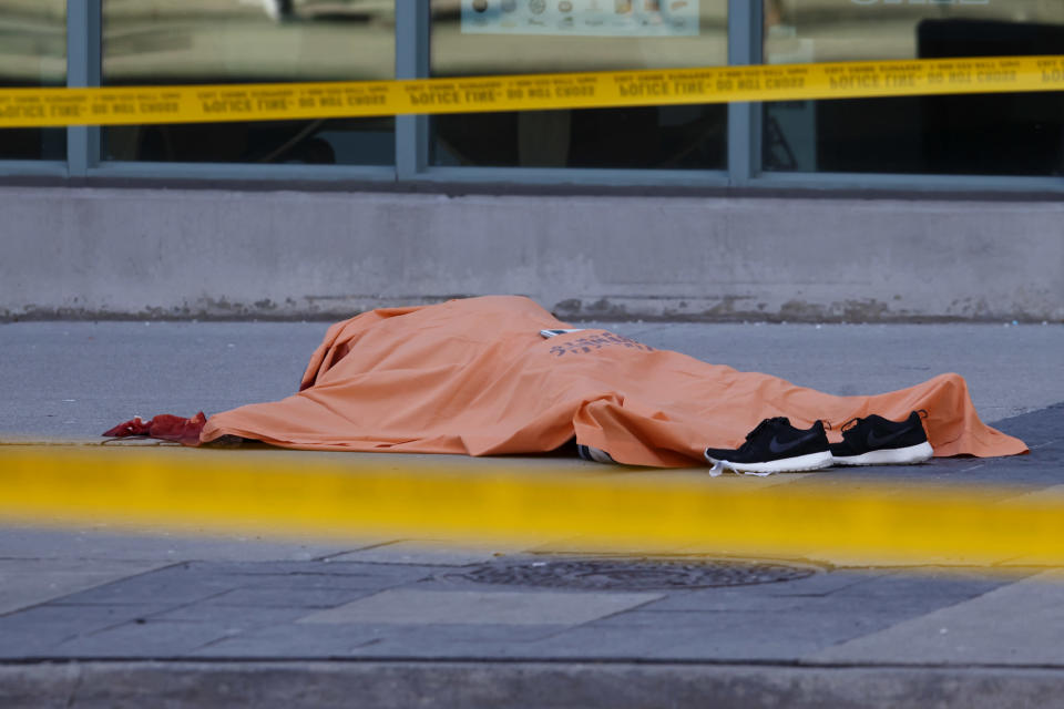 <p>A tarp covers an unidentiified body on Yonge St. at Finch Ave. after a van plowed into pedestrians in Toronto. Cole Burston/Getty Images </p>