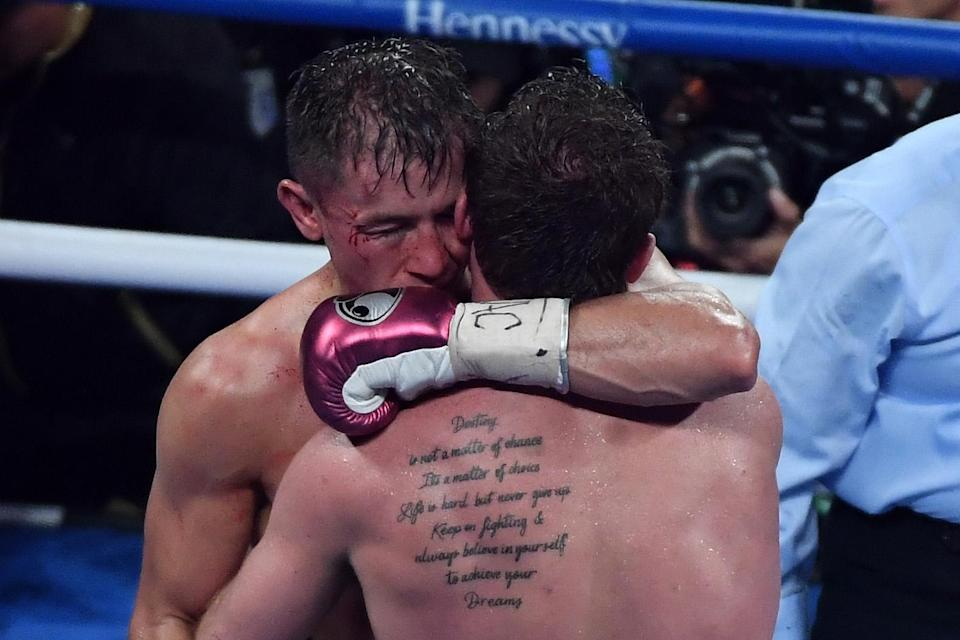 Gennady Golovkin (L) and Canelo Alvarez embrace following their rematch on Sept. 15, 2018, in Las Vegas. They could meet in a third fight later this year since both are now signed with DAZN. (Getty Images)