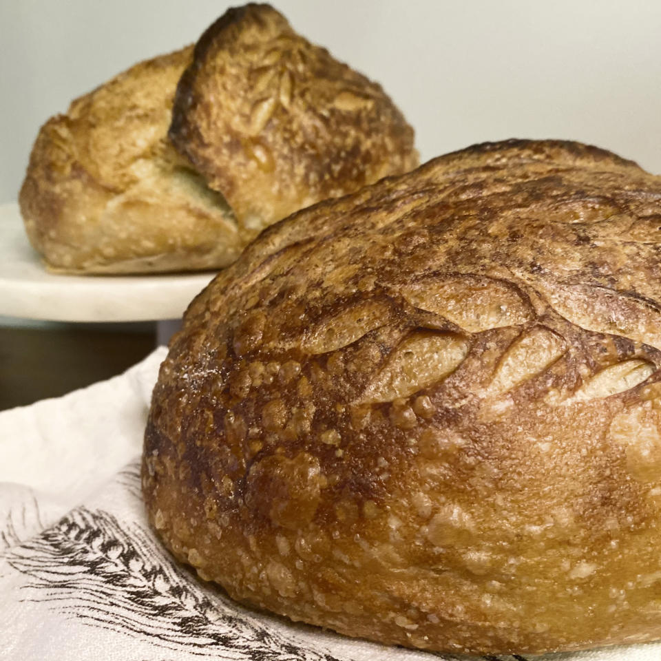 """Loaves of sourdough bread made by Broadway performer Max Kumangai are displayed in New York. The triple threat from the musical """"Jagged Little Pill"""" has leaned into a fourth skill as the pandemic marches on: baking and selling his own sourdough. (Michael Lowney/Humpday Dough via AP)"""
