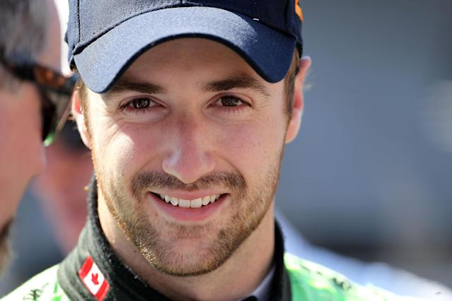 INDIANAPOLIS, IN - MAY 18: James Hinchcliffe prepares to drive the #27 Team GoDaddy.com car during Indianapolis 500 practice at Indianapolis Motor Speedway on May 18, 2012 in Indianapolis, Indiana. (Photo by Andy Lyons/Getty Images)