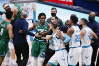 Coaches and officials separate Dallas Mavericks and Charlotte Hornets players during a scuffle in the second half of an NBA basketball game, Wednesday, Dec. 30, 2020, in Dallas. Charlotte Hornets forward Cody Martin (11) and Dallas Mavericks forward James Johnson (16) were both ejected for taunting. Charlotte won 118-99. (AP Photo/Brandon Wade)