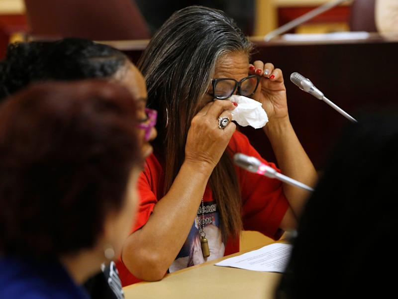 Theresa Smith, right, the mother of Caesar Cruz, who was killed in a confrontation with police, wipes her eyes after testifying against a police-backed law enforcement training bill by state Sen. Anna Caballero, D-Salinas, during an April 23 hearing in Sacramento.