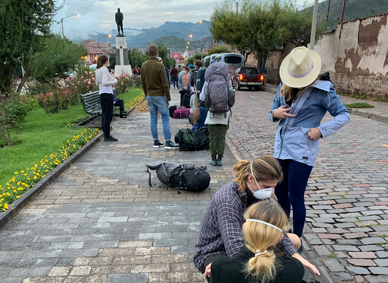 Homeward bound: British travellers wait for buses in Cusco to take them to the city's airport for a flight to Lima and a connection to London: Sarah Baxter
