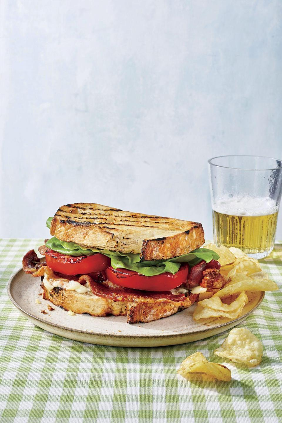 """<p><strong>Recipe: </strong><a href=""""https://www.southernliving.com/recipes/smoky-grilled-blt"""" rel=""""nofollow noopener"""" target=""""_blank"""" data-ylk=""""slk:Smoky Grilled BLT"""" class=""""link rapid-noclick-resp""""><strong>Smoky Grilled BLT</strong></a></p> <p>""""Occam's razor says that 'the simplest explanation is usually the best one.' Of all the beautiful dishes you can make with juicy summer tomatoes, the most uncomplicated (and in my opinion, the best) thing you can do with them is put them on a sandwich. I prefer a BLT over the purist's tomato sandwich, and I'm not afraid to jazz it up with a little avocado or fancy bread. Regardless, the star of the show, that thick, ripe slice of tomato, can't help but remain in the spotlight."""" Mary Shannon Hodes, Assistant Editor</p>"""