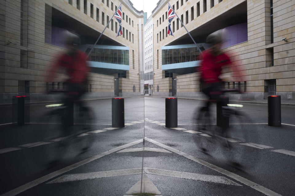 A man rides a bike in front of the British embassy on New Year's Eve in Berlin, Germany, Thursday, Dec. 31, 2020. Eleven months after Britain's formal departure from the EU, Brexit becomes a fact of daily life on Friday, Jan. 1, 2021. (AP Photo/Markus Schreiber)