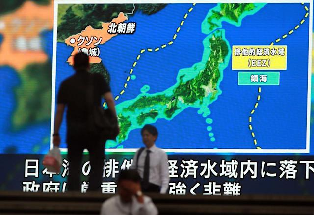 <p>People pass a public TV screen broadcasting news of North Korea's ballistic missile which landed in the waters of Japan's economic zone (EEZ) in Tokyo Tuesday, July 4, 2017. (Photo: Eugene Hoshiko/AP) </p>