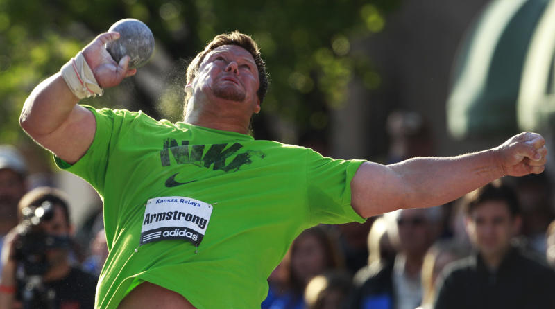 Dylan Armstrong, of Canada, competes in the elite shot put event during the Kansas Relays athletics meet Wednesday, April 20, 2011, in Lawrence, Kan. (AP Photo/Orlin Wagner)