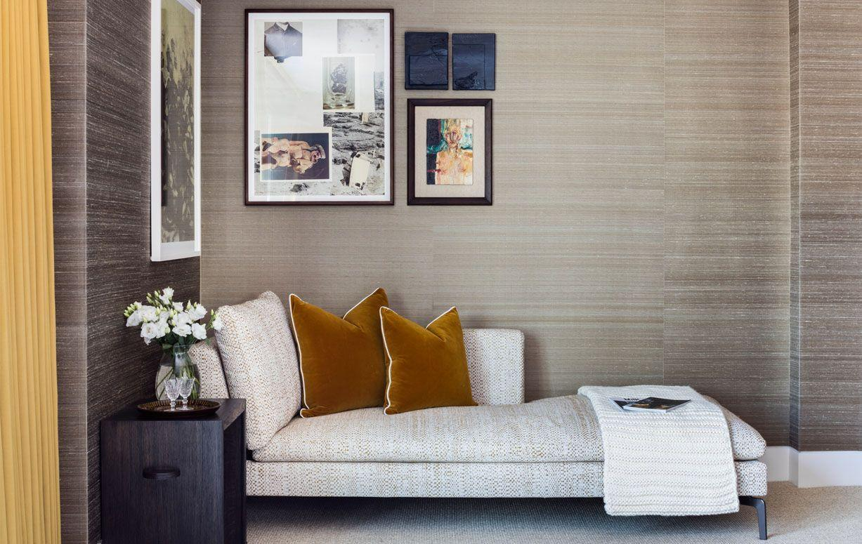 "<p>In this study designed by <a href=""https://studioashby.com/"" target=""_blank"">Studio Ashby</a>,  the slight shimmer of the grasscloth ignites the entire room. The gallery wall adds a contemporary touch while the burnt marigold throw pillows ground the space. </p>"