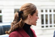 <p>Middleton loved that velvet hair bow so much that she did it twice in one month and we're definitely not complaining. This time she switched it from a low ponytail to a mid-level one and took out the twist detail at the back, instead choosing to curl the tail. </p>