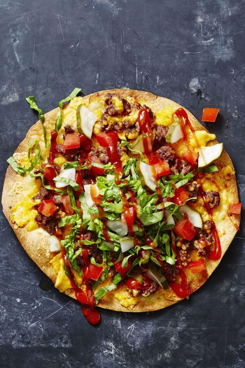 "<p>Sure, it may be tricky to make burgers using only one pan, but when you pile all of the best flavors on top of a crisp tortilla and bake it in the oven, you can have it all.</p><p><em><a href=""https://www.goodhousekeeping.com/food-recipes/a41226/cheeseburger-tostadas-recipe/"" rel=""nofollow noopener"" target=""_blank"" data-ylk=""slk:Get the recipe for Cheeseburger Tostadas »"" class=""link rapid-noclick-resp"">Get the recipe for Cheeseburger Tostadas »</a></em></p>"
