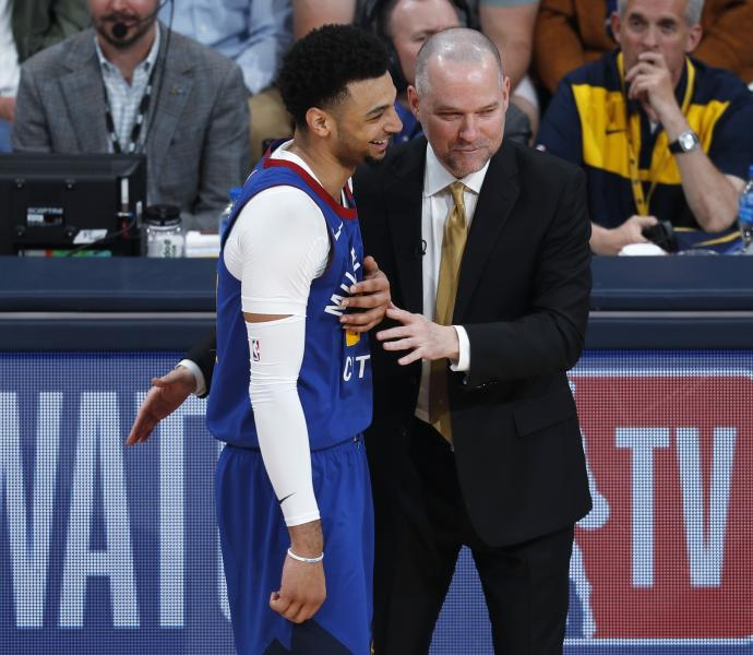 Denver Nuggets guard Jamal Murray, left, jokes with head coach Michael Malone during a break in the action against the San Antonio Spurs in the second half of Game 5 of an NBA basketball first-round playoff series Tuesday, April 23, 2019, in Denver. The Nuggets won 108-90. (AP Photo/David Zalubowski)